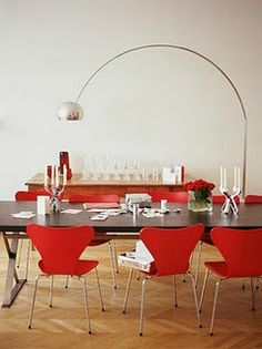 red chairs, black table, arc lamp, credenza
