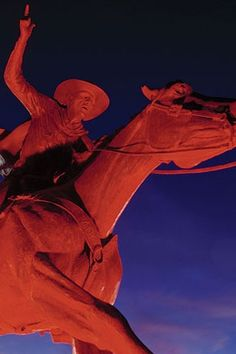 Will Rogers statue wrapped for football game at Texas Tech University