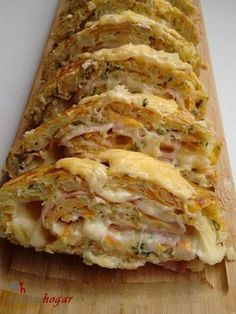 Tortilla Roll with cheese and ham For a baking tray 4 Potatoes (potatoes) medium 2 medium carrots 1 Large onion 5 Eggs M Parsley Mayonnaise Slices of yellow cheese Slices of ham 150 g Grated yellow cheese Fine salt Vegetarian Recipes, Cooking Recipes, Healthy Recipes, Tapas, Good Food, Yummy Food, Spanish Dishes, Snacks, Mediterranean Recipes