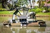 wheels of energy : Water Turbine a water wheel floating on the pond in a park