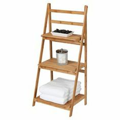 """With 3 slatted bamboo shelves, this eco-friendly ladder design is the perfect spot to stow fluffy towels and a basket of guest-worthy soaps.  Product: Ladder shelfConstruction Material: 100% Bamboo Color: Natural Features: Three shelvesEco-friendlyDimensions: 40"""" H x 18"""" W x 13"""" D"""