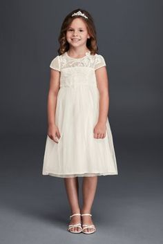 Simple yet elegant, your flower girl will lookadorably chicon your special day!  Meshdress features illusionneckline with elegantly crafted lace appliques.  A-line silhouette with cap sleeves and delicate ruched bodice.  Sizes 2T-14. Available in Ivory and White.  Fully lined. Imported polyester. Button closure. Dry clean only.  Special Value! Final price listed, no additional discounts apply.
