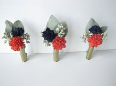 Navy Blue and Coral Casing Boutonniere by TheBackyardGardener, $13.50. maybe with shotgun shells?