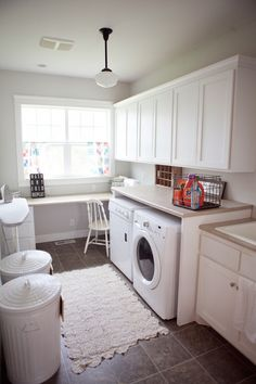 bright, white laundry room....the sign- wash, dry, fold, repeat....the old milk crate is great too.