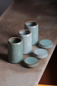 Florian Gadsby. Small store jars, lids off, fired together with small waddings between to keep the glazes from fusing. #pottery #ceramics #clay #craft #stoneware