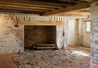 Basement kitchen fireplace at seventeenth-century Bacon's Castle in Surry County.. would love a big fireplace you could also cook on with the old fashioned iron arm
