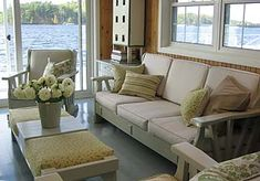 Season 2 design inc. Sarah Richardson remodels a boathouse in cottage decor. I love the furniture, which she found at Goodwill. She had the wood painted and recovered the cushions. I think it is the perfect cottage look!