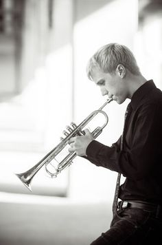 Senior portraits downtown. Playing a trumpet. Portrait Photographer - Ryan Davis Photography, Rockford, IL.