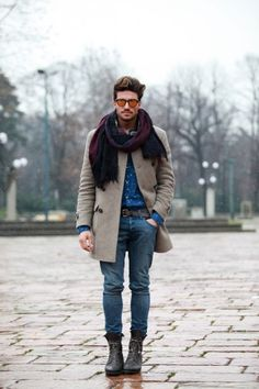 Scarf, oatmeal coat, and Chelsea boots: a winning combination.