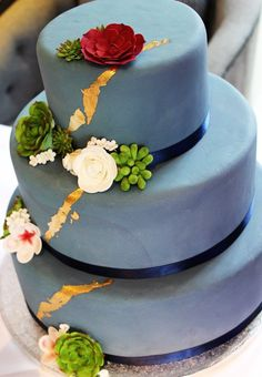 Three tier navy & gold succulents cake