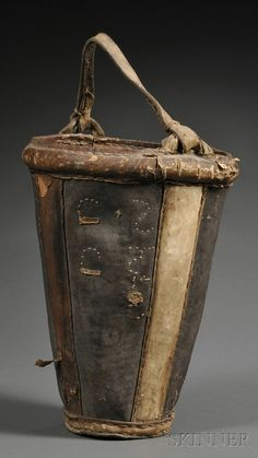 Rare Eskimo Wood and Hide Bucket | c. late 19th century, the tapered form with two-color panels, reinforced rim, and rawhide carrying handle