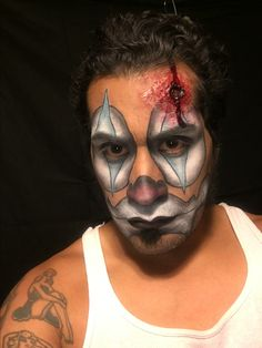 Bullet wound and cholo clown by Elvia Olivarria Torres