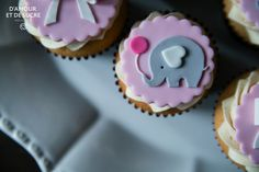 Elephant baby shower sweet table An adorable pink and white desserts table. White bow and elephant cupcakes, 2 tier elephant fondant cake and raspberry/vanilla macarons.