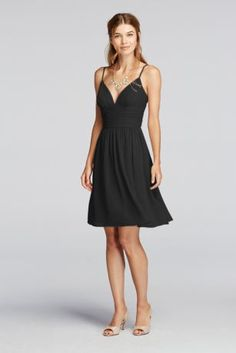 You will welcome this short and sassy dress into your wardrobe.   Spaghetti straps and a deep v neckline create a fun and flirty look.  A ruched bodice combined with a flowing skirt will compliment your figure.  Fully lined. Back zip. Imported polyester. Dry clean only.  Also available in Extra Length sizes as Style 2XLF19209.  To protect your dress, try our Non Woven Garment Bag.