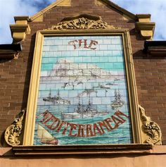 Carters Tiles - pub sign for the Mediterranean pub, Stamshaw Portsmouth (1904) showing the British fleet off Gibraltar and reflecting the naval history of the City. The pub was converted to flats in1978 but the sign has been preserved.
