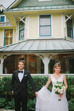 Newlyweds in front of the Sundy House.   Shea Christine Photography