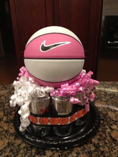 Coach gift.  Have players sign basketball and place on top soda or beer cans.  Wrap in cellophane to help keep in place.