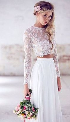- Two pieces - A Line silhouette - O neckline - Lace crop top is decorated with lace applique *NOTE* There are no sizes listed, because our wedding attire is custom made to fit each individual. After