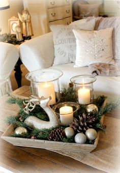 Christmas winter center piece decor. Reindeer, rustic, greenery, candles, country, pine comes, ornaments.: