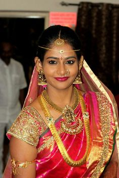 South Indian bride. Gold temple bridal jewelry. Jhumkis.Dark pink kanchipuram sari.Braid with fresh jasmine flowers. Tamil bride. Telugu bride. Kannada bride. Hindu bride. Malayalee bride.Kerala bride.South Indian wedding