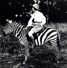 Osa Johnson, adventurer and American documentary filmmaker, riding a zebra, 1924. Photo from the Martin and Osa Johnson Safari Museum.