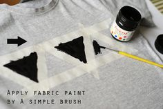 We need an old T-shirt, two colours of fabric paint and various brushes – those my be even the most simple, children ones. Using a paper triangle and some masking tape, stick the template ont…