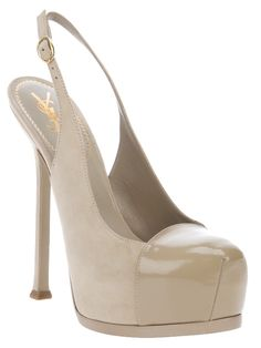 Beige patent leather platform pump from Yves Saint Laurent featuring a round toe, a buckle fastening sling back strap, a leather covered stiletto heel, a leather covered platform and a leather sole.