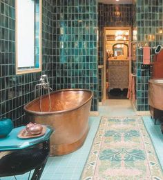from Sköna hem - Copper and Blue tiled bathroom. Huge copper tub, perfect for bathing!