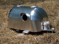 airstream birdhouse  I hope it is air conditioned, cute though