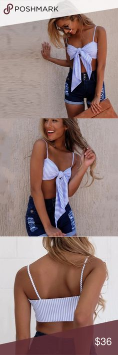 Striped Bow Crop Top Adorable blue and white striped crop top with front tie. Super cute and perfect for summer. Can be worn as a swimsuit bikini top or with shorts. This top will fit no more than a C cup. Tops Crop Tops