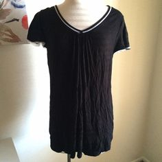 Sleep tee So soft and comfortable! It's a black sleep tee. It has white accents on it. V neckline. 95% rayon and 5% spandex. Worn twice. George Tops Tees - Short Sleeve