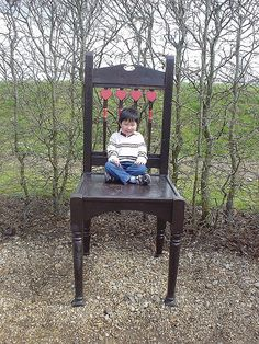 Edwin on the big chair by San Designs, via Flickr
