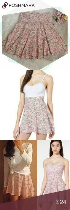 "American Apparel ""Roses"" skirt So comfortable and versatile. 95% brushed cotton and 5% elastin for easy soft fit. Waist band can be folded, scrunched or lowered for deired fit/length. Wear as a top with shorts or as a mini-dress.  Wear with tank top or throw over bathing suit for beach to boardwalk transitioning. Size large. Waist: 30"" with additional stretch.  Length: 19-22"". NWOT. (#BF.A8) American Apparel Skirts Mini"