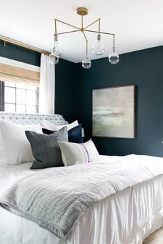 Big bed with a lot of pillows, looks all soft and comfy, wanna sink into it ------------ Best Bedroom Decor of 2017- bold wall color