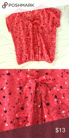 Pink floral blouse with bow Pink floral blouse with bow. Cinched bottom at the belt line. Faux buttons and just slips overhead. More of a sheer material but not see-through. Navy, gray, cream, and light pink flower accents. Forever 21 Tops Blouses