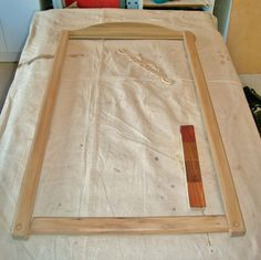 The frame has been sanded smooth as glass and is ready for re-assembly. I made a test strip for stain colors on a scrap piece of pine because I have to match this mirror with another piece of furniture.