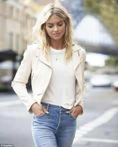 No faults here: The mother-of-one sported a white T-shirt, tucked into a pair of lightwash jeans, and accessorised with a leather jacket and delicate necklace