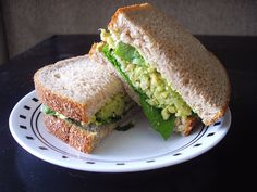 cooking ala mel: Smashed Chickpea & Avocado Sandwich. SOOO FREAKING GOOD! Add garlic powder, dill seeds, and a good amount of spring onion, top with pickles and lettuce/spinach and it's so yummy!