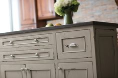 """Dura Supreme Cabinetry shown with the Marley cabinet door style in Knotty Alder with Heritage Paint finish """"F""""."""