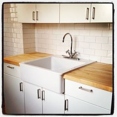 Butcher block, white subway tile, and white cabinets keep it clean ...
