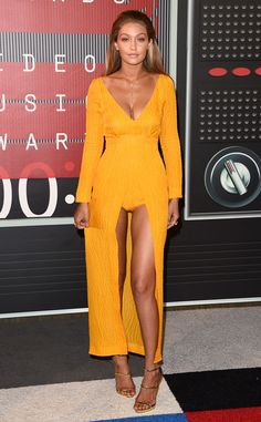 GIGI HADID Bright spot indeed! The Guess model slips into a citrus-hued Emilia Wickstead number with a revealing center slit.