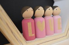 """These Love Peggie friends make the perfect Valentines gift, something that they will enjoy playing with far beyond valentines day.Each doll has been handprinted with water based paints and finished with a water based varnish.The set comes with 4 peg dolls in a small drawstring bag for easy storage.Each doll measures2-5/16"""" tall"""