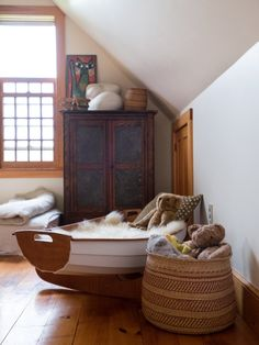 Kate's father masterfully built the boat bassinet, seen in her son Leland's sleeping nook - Kate & Nick's Back-to-the-Land Vermont Home (and Yurt!)