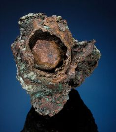 Copper - A stunning one of a kind specimen. The Copper lodes of the Upper Peninsula of Michigan produced a number of different forms of Native Copper. Rounded, hollow structures of metallic Copper called skulls are found only here. In addition, many of the mines produced actual crystals of Copper as well. This copper skull conceals a sharp dodecahedral Copper crystal peering out from the dark interior.  Overall measurements: 3 x 2 x 1.5 inches (7.6 x 6.4 x 3.8 cm)