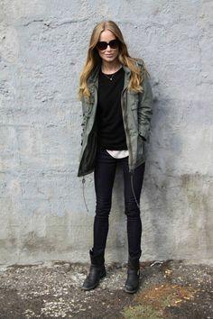 Utility jacket, black sweater over white t-shirt, dark wash skinny jeans, black boots