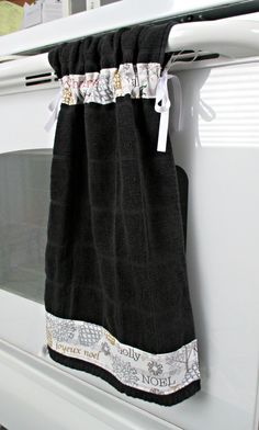 Tie Top Towels-Black Kitchen Towel accented with Joyeux Noel Music Metallic fabric; attaches to stove handle by allwrappedupandmore on Etsy