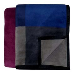 The Bocasa Mystic Woven Throw blanket features vibrant color blocking and paired with quality German craftsmanship. This distinctive blanket keeps will keep you warm and add a splash of color to any room.