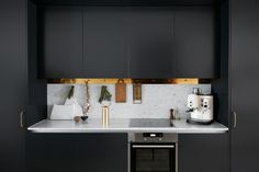 I've seen black kitchens with white marble worktops before and I think they are super nice, but this brass border on the top for hanging kitchen utensils really takes this one to another level. Such a nice idea to extend … Continue reading →