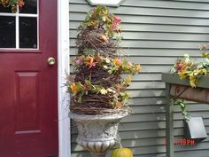 Outdoor Topiary out of a tomato cage