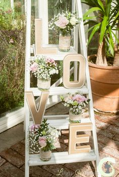 Shabby chic ladder decorated with flowers